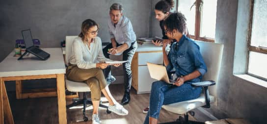 Diverse business group working together